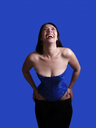 Young Woman Blue Corset Skirt Pulled Down Фото со стока