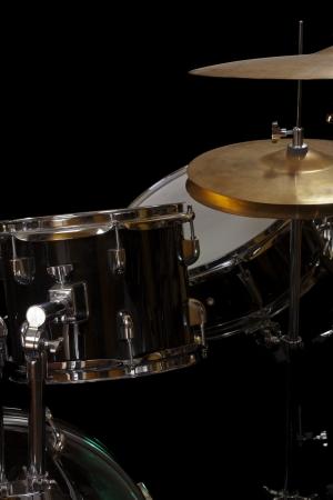 Closeup of Drum Kit Against Black Background Stock Photo