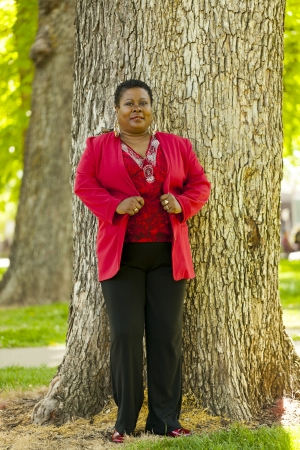 Heavy Older Black Woman Standing Outdoors Red