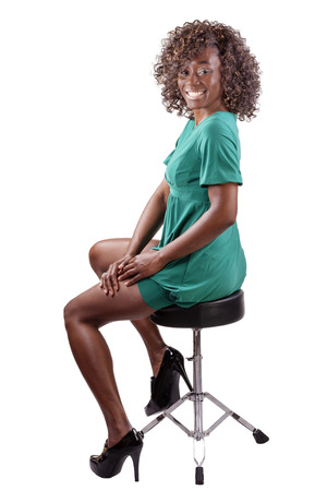 Smiling African American Woman Sitting On Stool photo