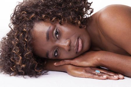 Pretty Black Woman Reclining Portrait Bare Shoulders photo