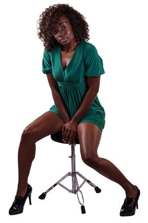 Attractive Black Woman Sitting Short Dress Legs photo