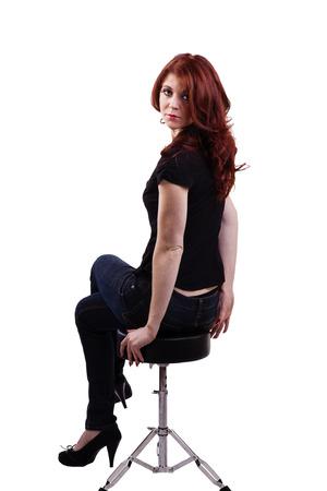 stool: Caucasian Woman Sitting On Stool Jeans Redhead