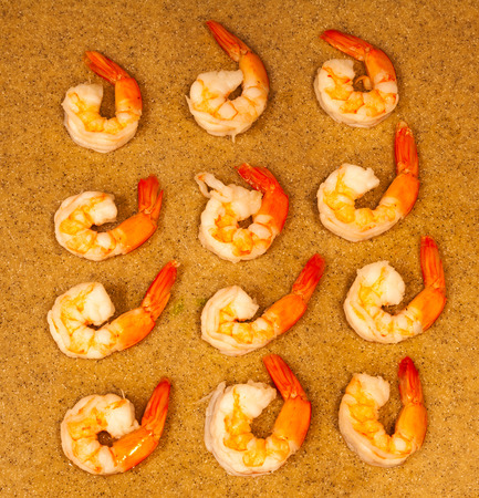 Arrangement Of Twelve Cooked Shrimp With Tails On