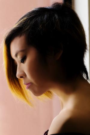 asian american: Profile Portrait With Window Light Asian American Woman