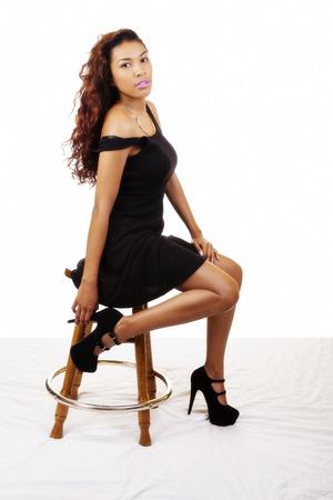 stool: Young Hispanic Woman Black Dress Sitting Stool