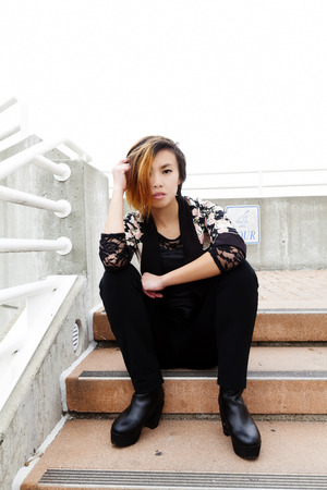 asian american: Asian American Woman Sitting On Steps Pants