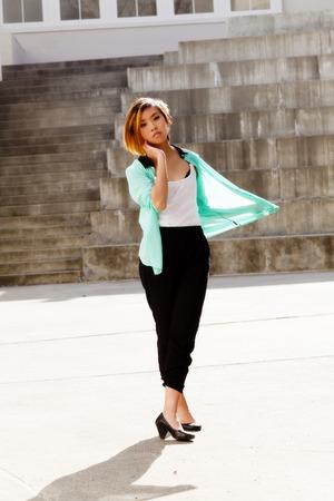 asian american: Skinny Asian American Woman Standing Pants And Shirt