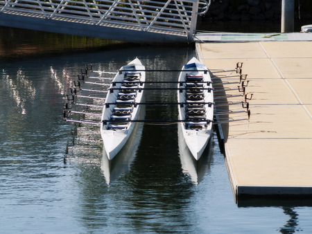 sports shell: Two Rowing Shells Empty Sitting At Doc Side