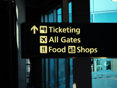 ticketing: Direction Sign Inside Airport Ticketing Gates Food Shops