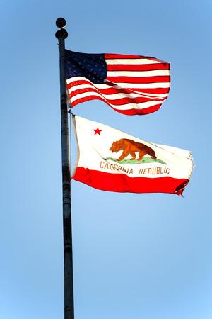flag pole: Flag Pole Blue Sky United States And California Flags Stock Photo