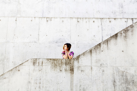 asian american: Asian American Woman Surrounded By Cement Walls