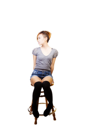 Skinny Attractive Asian American Woman On Stool