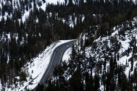 snow covered mountain: Snow Covered Mountain With Clear Highway Single Car Stock Photo