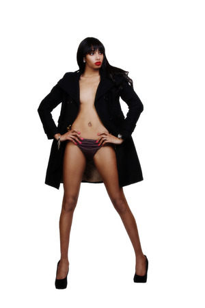 attracive: Skinny Black Woman Standing Jacket And Panties Stock Photo