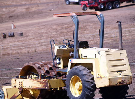 earth moving: Heavy Yellow Earth Moving Machinery In Field Stock Photo