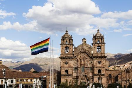 cusco: Cusco Flag With Compania De Jesus Church In Background