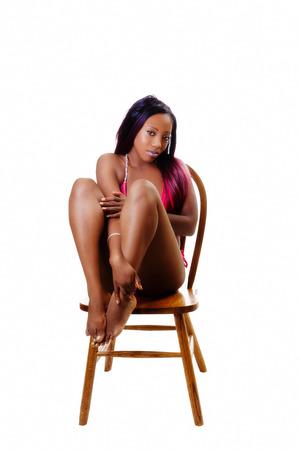 woman black: African American Woman Sitting On Chair Red Bikini