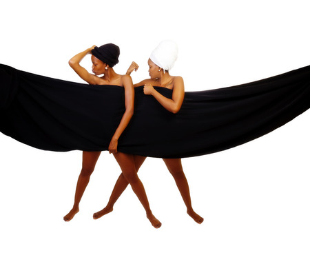 implied: Two African American Women Standing In Head Scarves