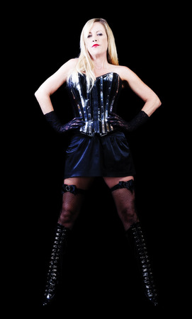 Blond Middle Aged Woman Standing Black Dress Corset Boots