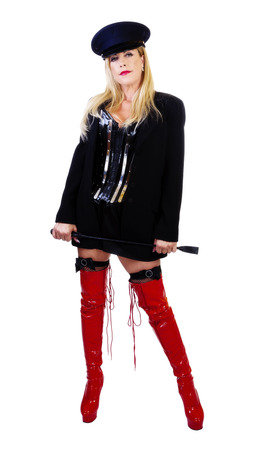 Woman Standing With Red Boots Jacket Corset Riding Crop