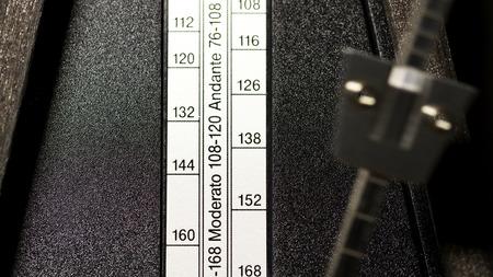 metronome: Closeup Of Wooden Metronome Tempo Setting Strip And Arm Stock Photo