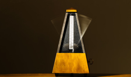 metronome: Wooden Mechanical Metronome With Motion From Arm Movement