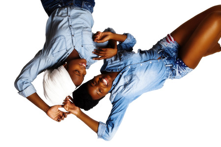 Two Black Women Laughing Shorts Shirts Head Scarves Stock Photo