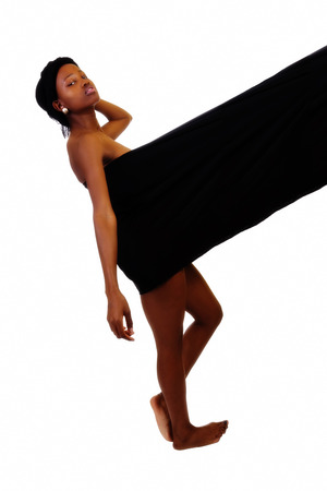 back cloth: Black Woman Leaning Back Supported By Cloth Stock Photo