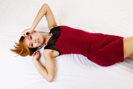Attractive Asian American Woman Reclining Red Dress