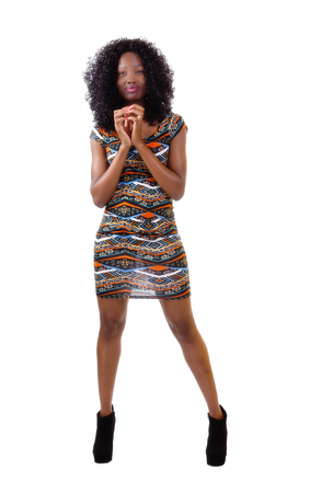 woman in dress: Attractive Black Woman Standing In Patterned Dress