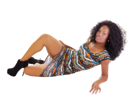 reclining: Skinny Attractive Black Woman Reclining In Dress Stock Photo