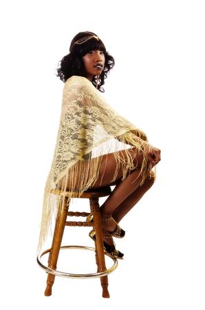 sitting pretty: Attractive Black Woman Sitting Golden Shawl Wrap