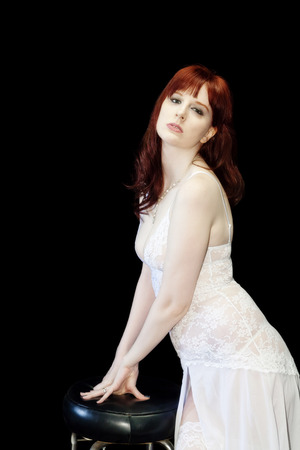 red head: Caucasian Woman Red Head Standing In White Lingerie Stock Photo