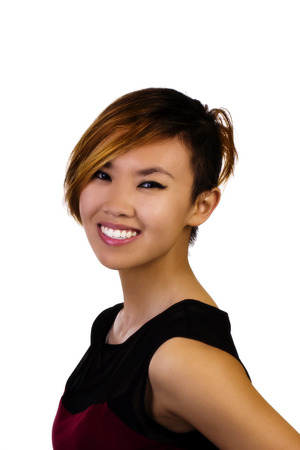 asian american: Attractive Asian American Woman Smiling Portrait In Dress
