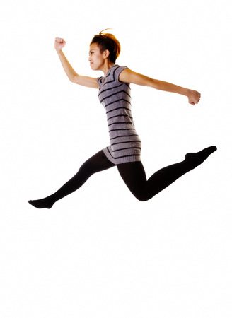 skinny woman: Skinny Woman Jumping In Knit Dress And Stockings