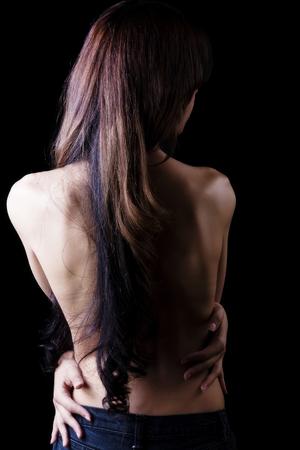 seins nus: Femme Latina Topless In Blue Jeans De Retour Banque d'images