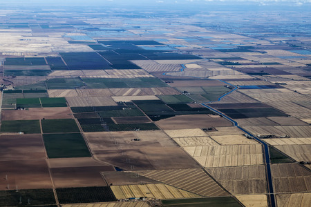 farm land: Aerial View Farm Land Irrigation Canals Water Power Lines