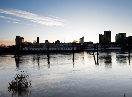 pilings: Sacramento City Waterfront Seen Across The River In Early Morning Editorial
