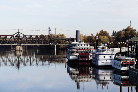 paddle wheel: River Boats Sacramento California With Reflections In Water