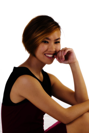 asian american: Asian American Woman Sitting In Dress Smiling