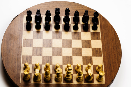 starting position: Old Magnetic Chess Board With Pieces In Starting Position