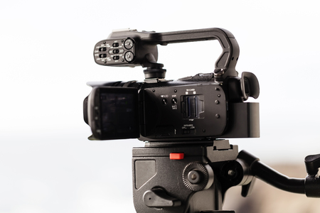 tripod mounted: Video Camera Mounted On Fluid Head Tripod