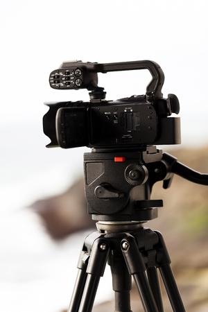 tripod mounted: Video Camera Mounted On Tripod With Fluid Head