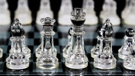 Tight Shot Of Bishops King And Queen Chess Pieces Set Up On Board In Initial Locations