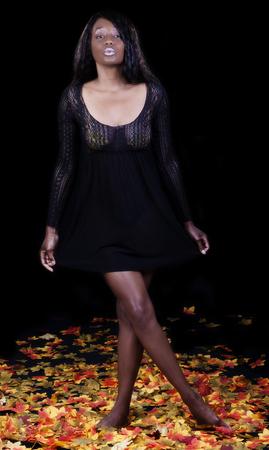 nightie: African American Woman In Black Nightie Standing On Silk Autumn Leaves