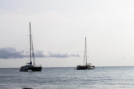 Two Sailboats At Anchor On Ocean Kona Hawaii