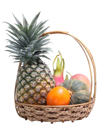 Fresh fruits in wicker basket on white background  photo