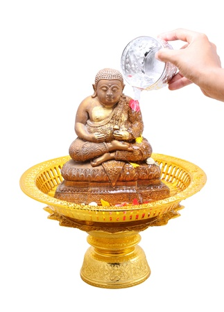 songkran: Showering Buddha image in SongKran festival, Thailand