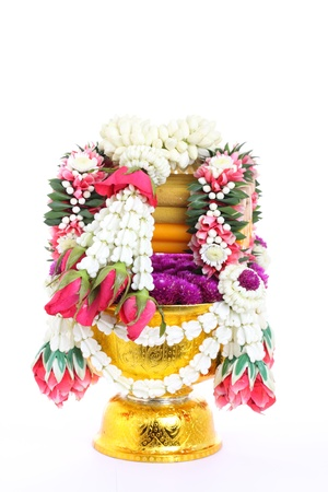 flower decorated on tray with pedestal to be used in the ceremony for paying respect to teachers or elder people  photo